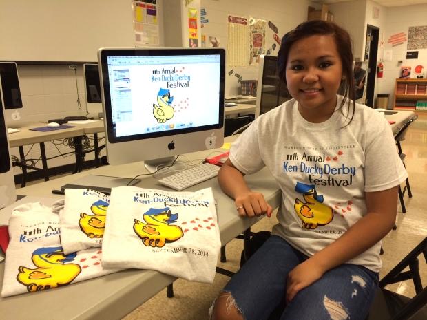 Mirielle Pangan displays her winning artwork in the Ken-Ducky Derby T-shirt Design Contest